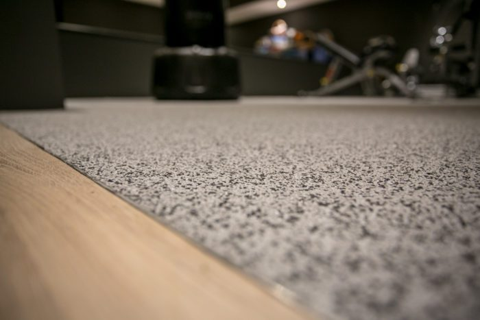 poured rubber flooring used in a gym setting